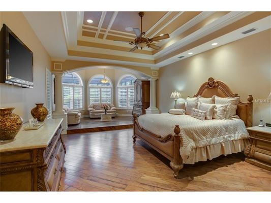 A triumph of style and design florida luxury homes for 13x13 bedroom design