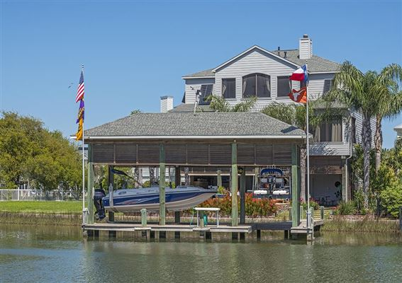 Re imagined custom home on the water texas luxury homes for Canal front home designs
