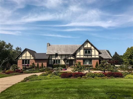 Handsome tudor style home on 57 park like acres michigan for Tudor style house for sale