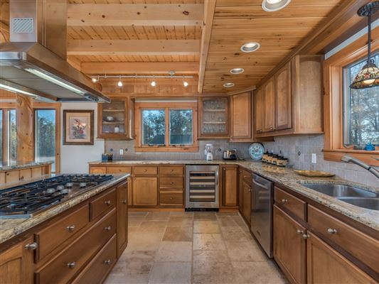 Beautiful white cedar log home in union mills luxury properties