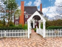 Luxury properties well-maintained English shingle style