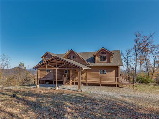 Beautiful white cedar log home in union mills luxury real estate