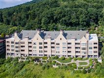 Mansions THREE bedroom unit boasts long range mountain views