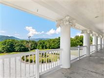 Luxury homes this beautiful Southern Colonial has stunning panoramic mountain mountain views