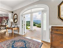 this beautiful Southern Colonial has stunning panoramic mountain mountain views luxury homes