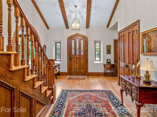 Luxury properties finely finished Tudor revival home
