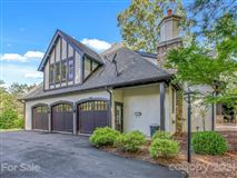 finely finished Tudor revival home luxury homes