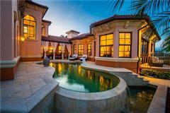 Mansions in custom Mediterranean-style waterfront residence
