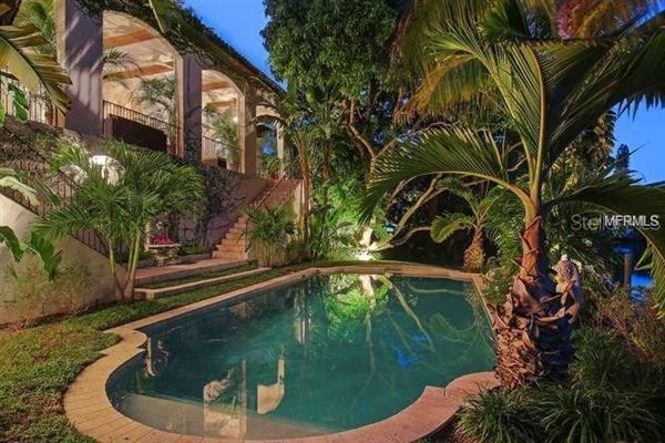 Luxury properties sun-soaked palm beach estate