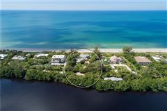 Luxury properties rare gulf-to-lagoon property