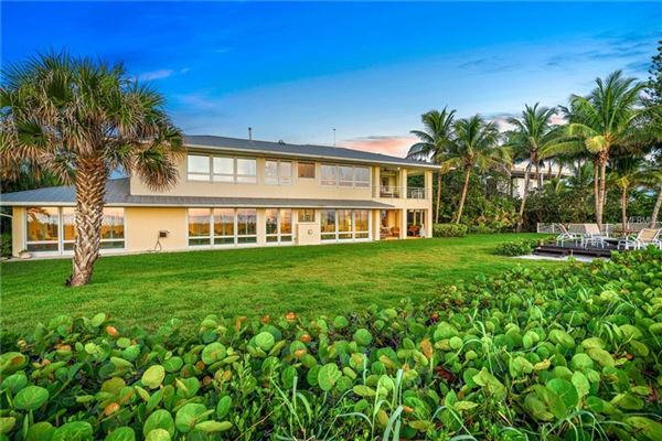 Mansions in rare gulf-to-lagoon property