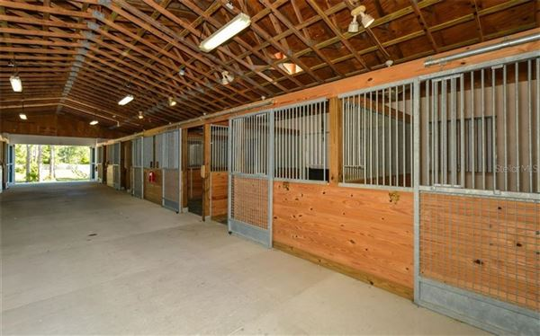 Luxury real estate 14 acre property with custom Horse Stable