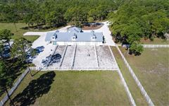 Mansions 14 acre property with custom Horse Stable