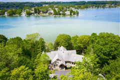 Luxury real estate STUNNING HOME ON PRIVATE WOODED BIG CEDAR EAST SIDE
