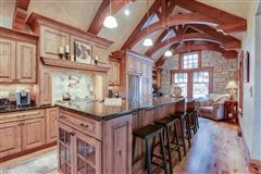 Luxury properties STUNNING HOME ON PRIVATE WOODED BIG CEDAR EAST SIDE