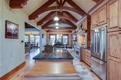 STUNNING HOME ON PRIVATE WOODED BIG CEDAR EAST SIDE luxury properties