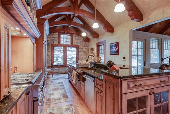 Luxury homes STUNNING HOME ON PRIVATE WOODED BIG CEDAR EAST SIDE