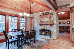STUNNING HOME ON PRIVATE WOODED BIG CEDAR EAST SIDE mansions