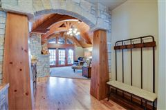 Luxury homes in STUNNING HOME ON PRIVATE WOODED BIG CEDAR EAST SIDE