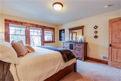 STUNNING HOME ON PRIVATE WOODED BIG CEDAR EAST SIDE luxury real estate