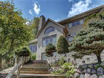 Luxury homes in impressive home on Crescent Lake