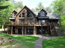 Luxury real estate beautiful log home on a quiet bay
