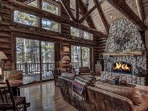 Luxury properties beautiful log home on a quiet bay
