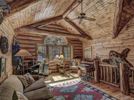 Luxury homes in beautiful log home on a quiet bay
