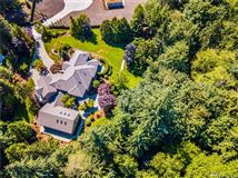 Exquisite craftsmanship in desirable Woodinville mansions