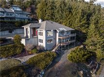 Luxury homes in fully renovated custom home with breathtaking bay views