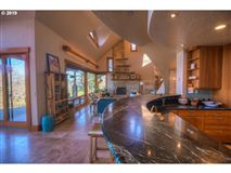 private custom home boasts a pool and deck luxury properties