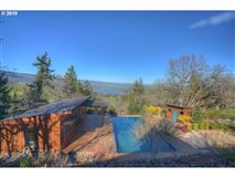 Luxury properties private custom home boasts a pool and deck