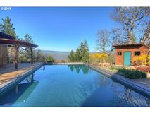 private custom home boasts a pool and deck mansions