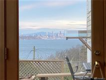 Luxury homes ENJOY YOUR MORNING COFFEE WITH PANORAMIC VIEWS OF THE SHIPPING LANES, DOWNTOWN SEATTLE AND MT. BAKER