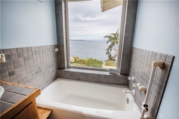 ENJOY YOUR MORNING COFFEE WITH PANORAMIC VIEWS OF THE SHIPPING LANES, DOWNTOWN SEATTLE AND MT. BAKER luxury properties