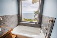 ENJOY YOUR MORNING COFFEE WITH PANORAMIC VIEWS OF THE SHIPPING LANES, DOWNTOWN SEATTLE AND MT. BAKER luxury real estate