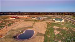142-plus acre farm with three custom homes mansions