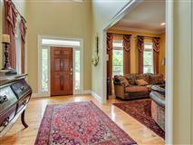 a grand home on a corner lot in prestigious Barrington Subdivision luxury homes