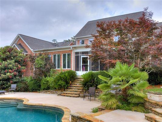 a grand home on a corner lot in prestigious Barrington Subdivision mansions