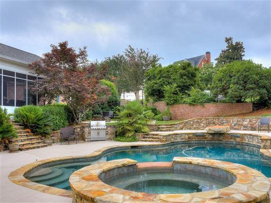 Luxury homes in a grand home on a corner lot in prestigious Barrington Subdivision