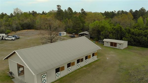 Mansions in 51-plus acre horse farm with custom post-n-beam home
