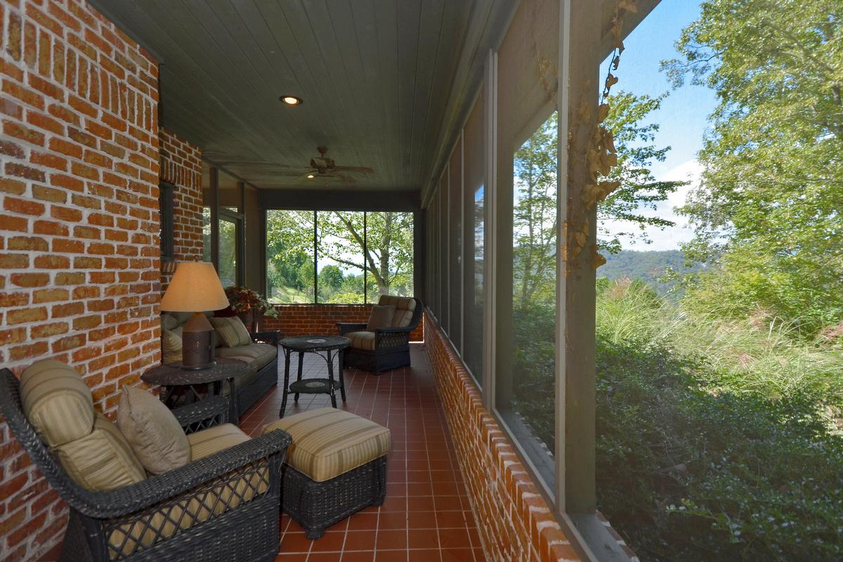 Luxury real estate Striking Mountain Estate with Waterfall and Views