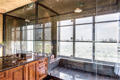 Mansions in elegant custom 19th floor unit in The Huntingdon