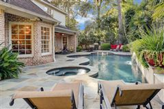 Luxury properties stately brick home in a gorgeous setting
