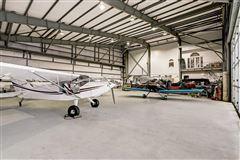 custom hangar house - finest in aviation lifestyle luxury homes