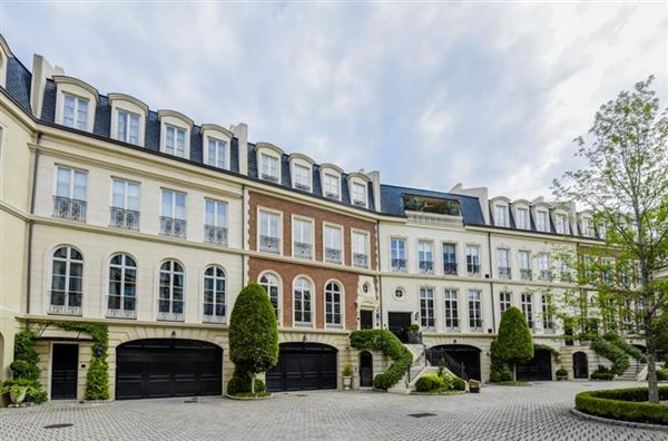 Luxury real estate townhome Modeled after Place de vogue in Paris