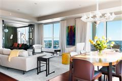 coveted corner unit with sweeping views luxury homes