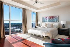 Luxury homes coveted corner unit with sweeping views