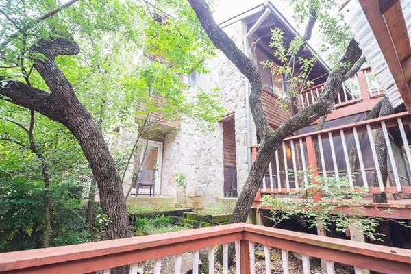 cedar home on treed lot in eanes luxury real estate