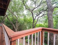 Luxury real estate cedar home on treed lot in eanes